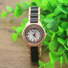 Free shipping!Promotional!Copy ceramic band brecelet watches,rhinestion decoraton in the case with moving stone,quart movement(China)