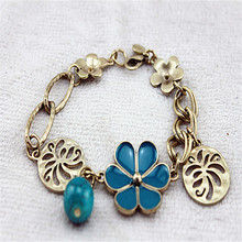 Fashion bracelet 2014 Fashion new pure and fresh and contracted flowers hollow out female hand catenary restoring ancient ways