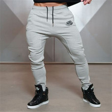 2017 NEW MEN GOLD JOGGERS FITNESS PANTS CASUAL ELASTIC COTTON MENS FITNESS WORKOUT PANTS SKINNY SWEATPANTS TROUSERS JOGGER PANT(China)