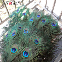 Top quality peacock feathers 20 Pcs/lot, length 25-32 CM beautiful natural peacock feather Diy jewelry Decorative Deco fittings(China)