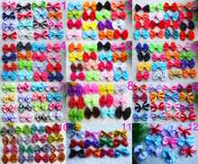 Wholesale 100pcs 12 Style Large Bowknot Mix Patterns Design topknot bows pet hair Clips Style dog hair pet grooming products(China)