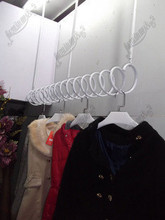 Wrought iron wall on clothing clothing store shelves Condole top clothing display shelf hanger