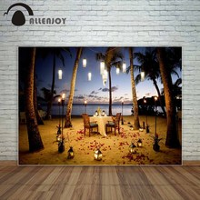 Allenjoy backdrop Table for romantic meal on the beach with lanterns chairs flowers palms sky sea photo background photo booth(China)