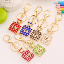 Hot Sale one piece Korea Creative Cute Gifts Wholesale With Action Figures Rhinestone Perfume Bottle Keychain Pendant Toys