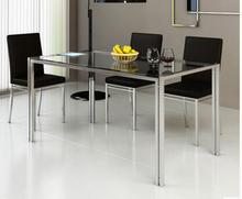 Steel glass dining table and chair combination. Stainless steel table