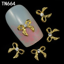 Blueness 10pcs Gold Glitter 3d Nail Bows Art Decorations with Rhinestones ,Alloy Nail Charms,Jewelry on Nails Supplies TN664(China)