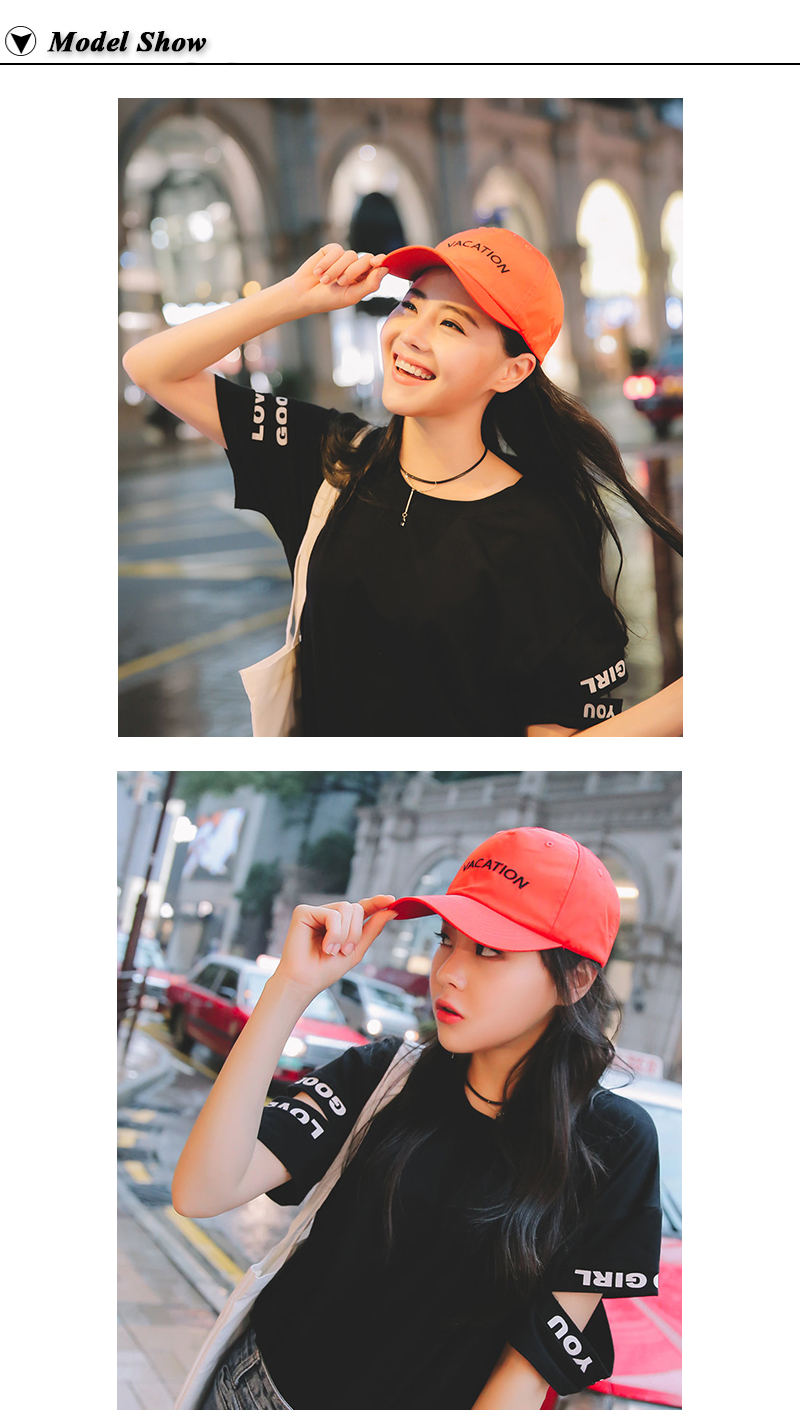 "Young Woman Wearing the Embroidered ""Vacation"" Baseball Cap in Orange Cap and Red Cap"