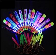 50Pcs Amazing LED Light Arrow Rocket Helicopter rotating Flying Child Toy Party Fun Gift Blue light Christmas gift