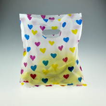 20x25CM 100pcs Colorful Hearts Design White plastic packing gift bag fashion jewelry Gift packaging plastic bags with handle