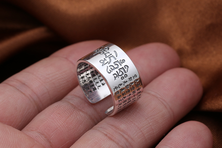 Stunning Solid 999 Sterling Silver Sanskrit Buddhist Mantra Rings in hand