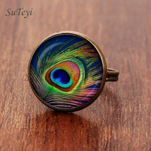 SUTEYI 2017 New Peacock Feather Ring Abstract Feathers Jewelry Art Nouveau Glass Peacock Photo Adjustable Rings For Women(China)