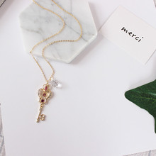 Free shipping women fashion new jewelry Personalized Trend beauty girl transparent key pendant carefully designed long section