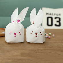 N2HAO 50pcs Rabbit Ear Plastic Candy Gift Bag Box Cute Bunny Cookies Bag Holloween Wedding Decoration Christmas Party Supplies(China)