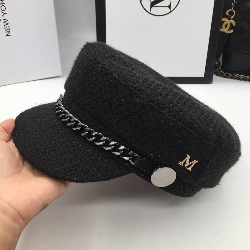Nueva Estrella tejer sombrero negro sombrero estudiante cadena de metal  marea calle newsboy cap ocio viseras e114ee7a4bc