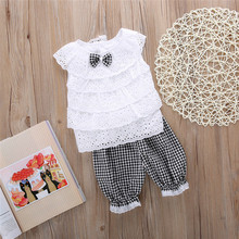 On April 2017 the new new female baby lace bow summer suit + stripe girls short sleeved shorts two piece set children