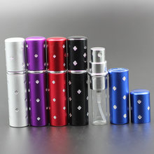 50pcs/lot 10ml Crystal Carved Designs Refillable Anodized Aluminum Glass Inner Bottle Perfume Bottle Engraved Spray Scent Bottle(China)