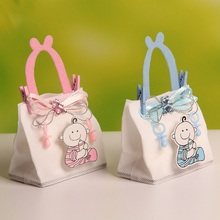 2016 New!! 7.5*4.5*12cm Baby Boy Figure Wedding Candy/Chocolate Bags Portable Favor Bags Nonwoven Fabric Candy Bag 12pcs