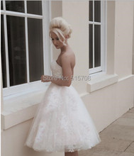Strapless short blush pink strapless vintage inspired tea length tulle and french corded lace gown wedding dress