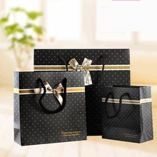 ROCOHANTI 10Pcs Customized Business Gift Bag Creative Bowknot Gift Packaging Bag Paper Shopping Bag With Handle Black Color(China)