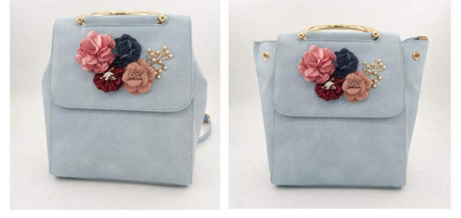 Lilledega kaunistatud seljakotid