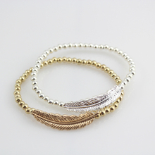 Free Shipping Beaded Fashion Bracelet with Leaf Charm in silver and gold. Fashion Charm Bracelet
