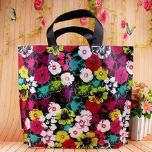 50pcs Big Colored flower print bags Shopping Handle Reusable Plastic Gift bags Boutique Clothes packing bags 35x30x8cm Retail(China)