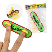 Mini Plastic Fingerboard Professional finger skateboard for kids novelty items Toy Finger Skate with spring and ring(China)