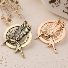 the hunger games brooch high quality vintage retro punk catching fire bird brooches pins for men women wholesale