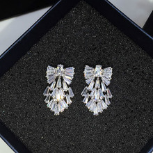 Hot selling Korea fashion Micro Paved Synthetic Diamonds bowknot stud earrings  white gold-color Party jewelry for women 2016
