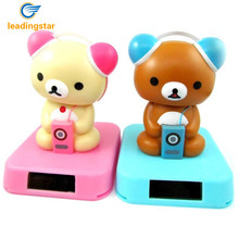 LeadingStar Solar Powered Automatically Swing Toys Lovely Shaking Head Wearing Earphone Bear Doll Gift for Children Randomzk30