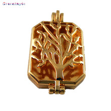 GraceAngie 2pcsTopPlate Fragrance Essential Oil Aromatherapy Diffuser Perfume Women Hollow Tree Locket Charms Pendant(China)