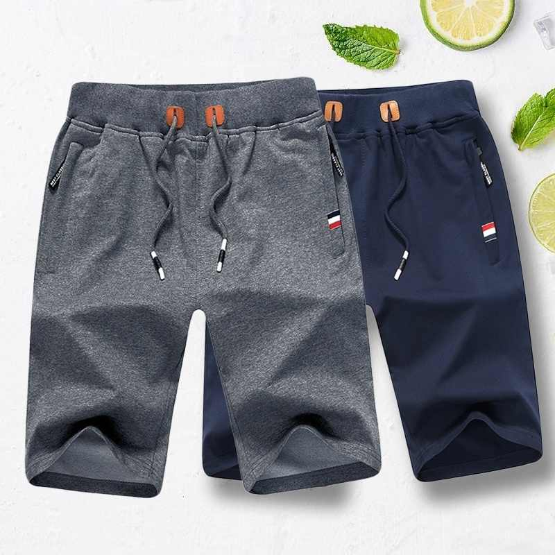 Los hombres playa pantalones cortos pantalones nueva moda de algodón deportivos  pantalones de Fitness deportivo corto efaf06fc7a40
