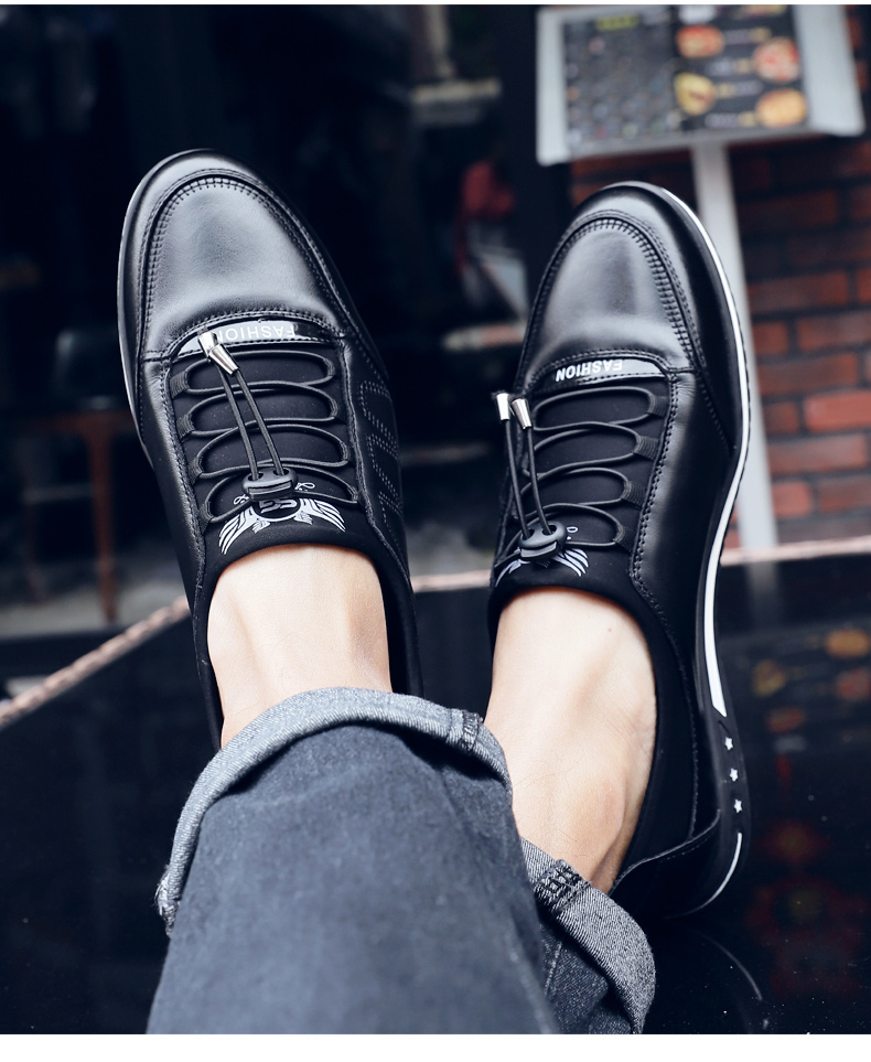 a pair of legs wearing black shoes