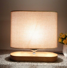 Modern table lamp wood light led light linen Cloth lamp shade oak wood oval base bed room Office table lamp(China)