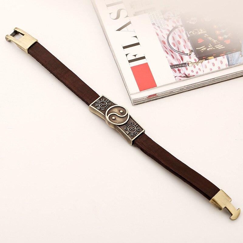 Bracelet yin yang en cuire posé à plat   OkO-OkO