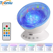 Tooniu Remote Control Ocean Wave Projector 12 LED &7 Colors Night Light with Built-in Mini Music Player for Living / bed Room(China)