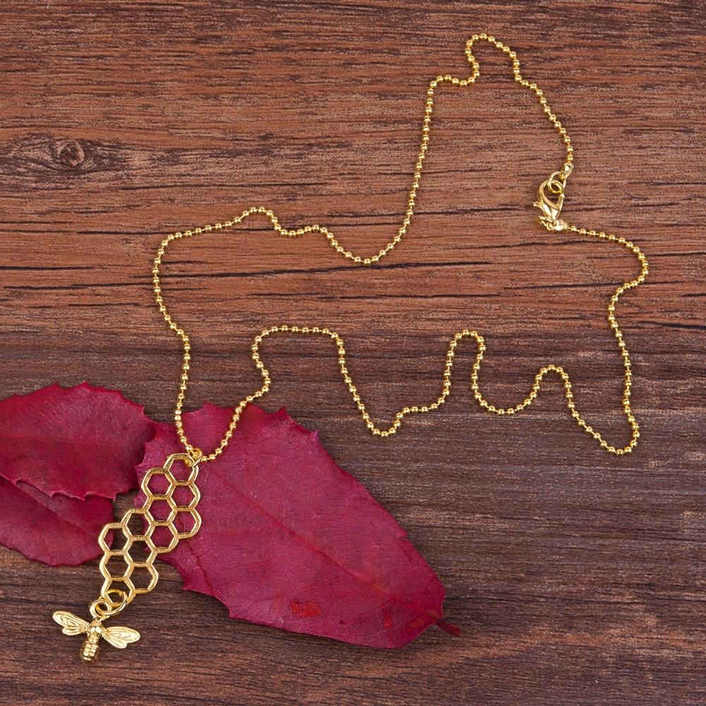 geekoplanet.com - Honeycomb & Bee Pendant Necklace