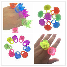120pcs/lot LED Light Up Flashing Hard Flower Rose Coral Crown Finger Rings Glow Kids Party Favors Toys Star Finger Ring(China)