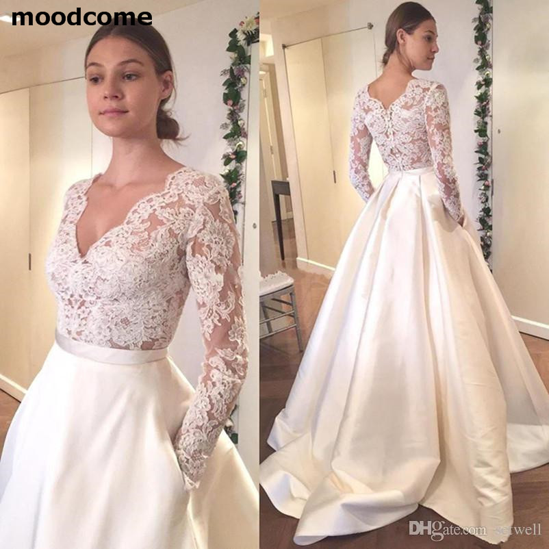 White Appliqued Lace Wedding Dresses Sexy Deep V-neck Illusion Long Sleeves A-line Wedding Gowns Bridal Dress