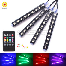4Pcs Wireless Remote Music Voice Sound Control Car RGB LED Flash Neon Interior Light Lamp Strip Dash Floor Atmosphere Lights(China)