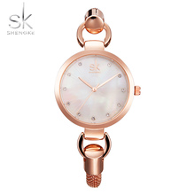SK New fashion women wristwatches elegant rose gold diamonds girl's clock hollow out Stainless Steel strap Quartz watch 2017(China)