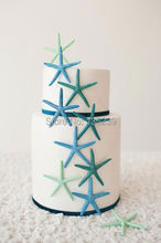 Sugar starfish tieback for the altar - Beach Wedding Idea - via Sand Petal Wedding