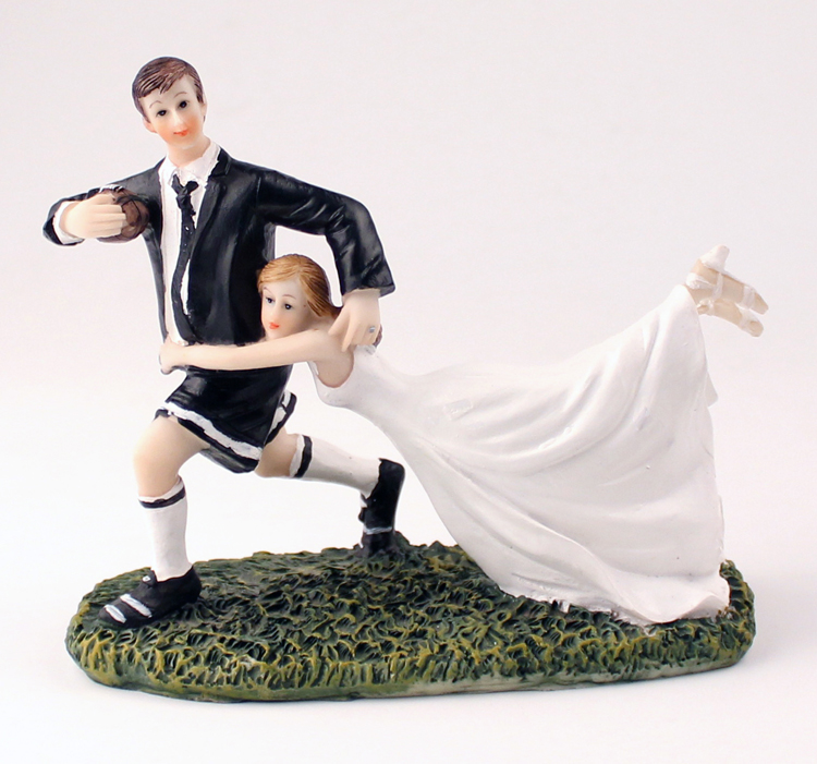 a love match rugby couple figurine A love match rugby couple figurine for those in love with each other and in love with the sport of rugby, this figurine is dynamic and totally entertaining as portrayed by the gravity defying pose, this couple are clearly in the game to win dress your cake and mini cakes with rugby view details.