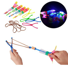New Creative LED Light Slingshot Elastic Arrow Rocket Helicopter Flying Toy Party Fun Gift(China)