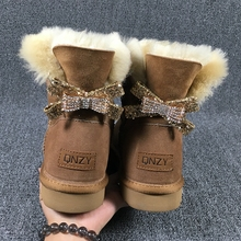 2017 high quality new type of bow tied snow boots, 100% natural Australian sheep skin, one female boots free delivery(China)