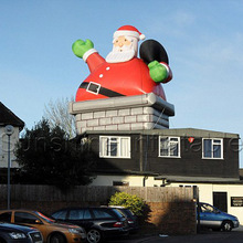 High quality giant outdoor christmas inflatable santa in chimney for sale
