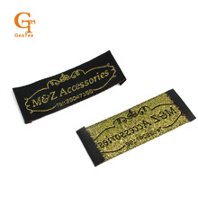 woven clothing labels for clothes, bags/women dress/toys scarfs brand name labels,black background with gold logo,straight cut