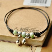 Free shipping! Nice green beads bell pendant black leather chain bracelet adjustable bangle cheap gift for girlfriend student(China)