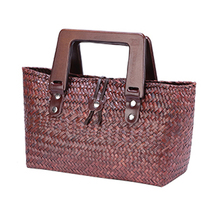 2017 new Thai version of the hand-woven bread straw bag woven bag wooden handle retro ladies handbag beach bag