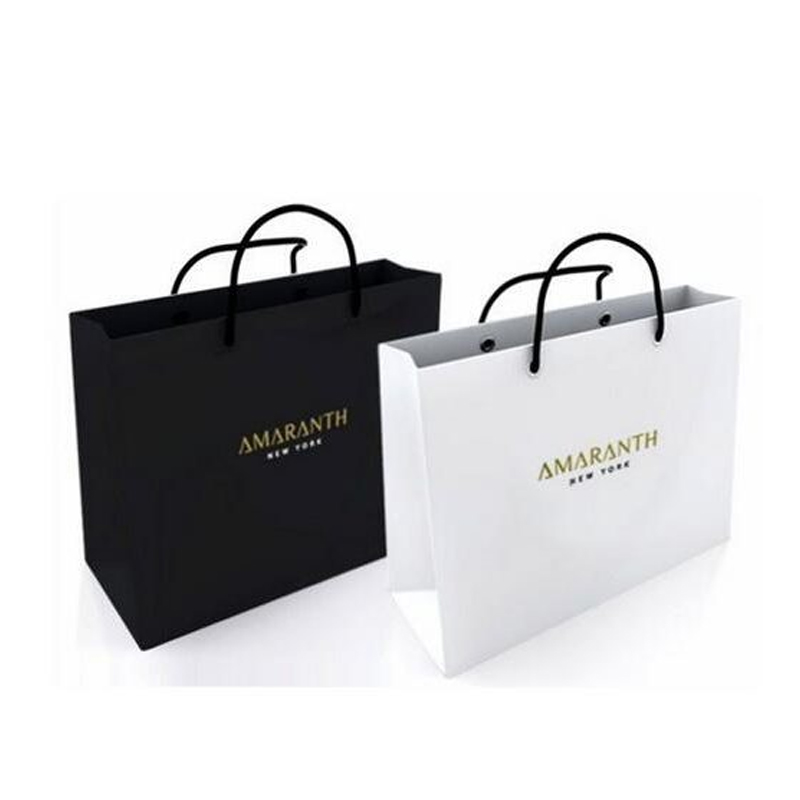white and black paper bags